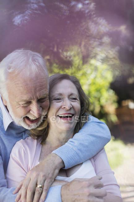 Affectionate, smiling senior couple hugging — Stock Photo
