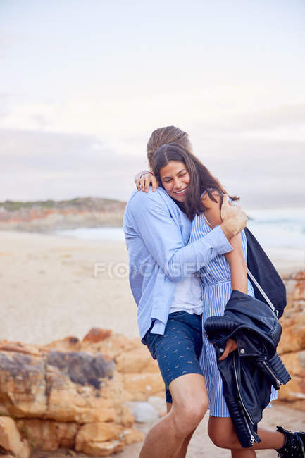 Affectionate couple hugging at beach — Stock Photo