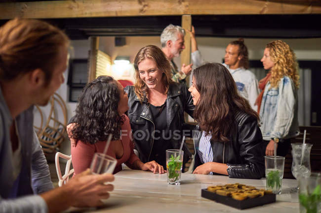 Friends hanging out, drinking on patio — Stock Photo