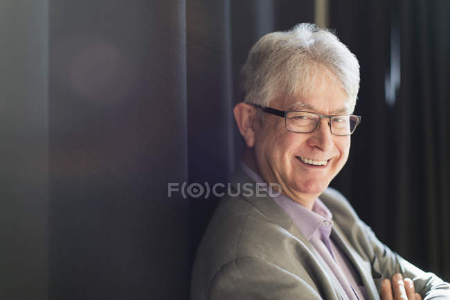 Portrait smiling, confident active senior businessman — Stock Photo