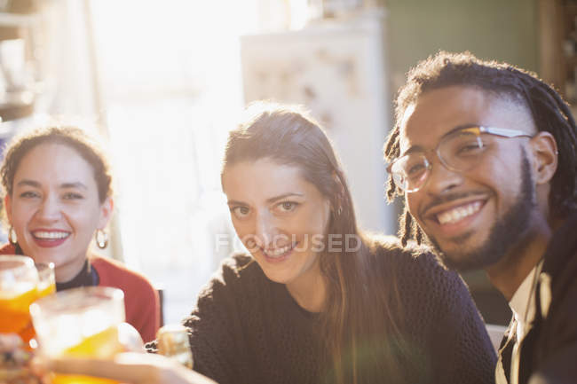 Portrait happy young adult friends toasting cocktails — Stock Photo