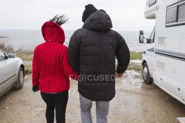 Couple walking outside motor home — Stock Photo