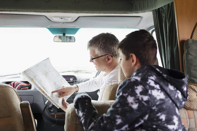 Father and soon looking at map in motor home — Stock Photo