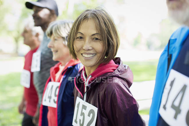 Portrait smiling, confident active senior woman at sports race starting line — Stock Photo