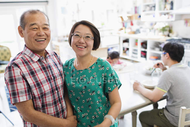 Portrait happy senior father and daughter in kitchen — Stock Photo