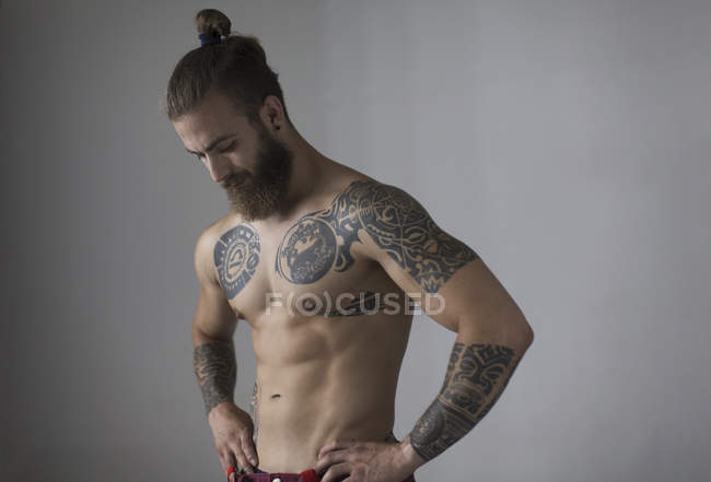 Portrait bare chested man with tattoos and beard — Stock Photo