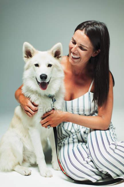 Portrait happy woman with dog — Stock Photo