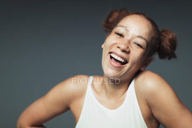 Portrait carefree woman with freckles laughing — Stock Photo