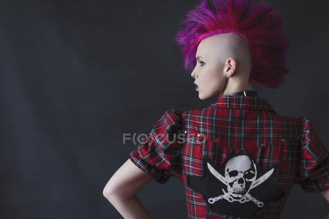Confident, cool young woman with pink mohawk — Stock Photo