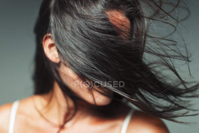 Wind blowing hair in womans face — Stock Photo