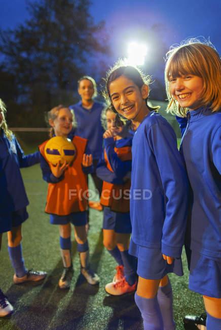 Portrait smiling, confident girls soccer team — Stock Photo