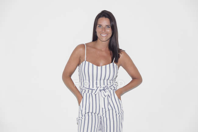 Portrait confident woman wearing striped romper — Stock Photo