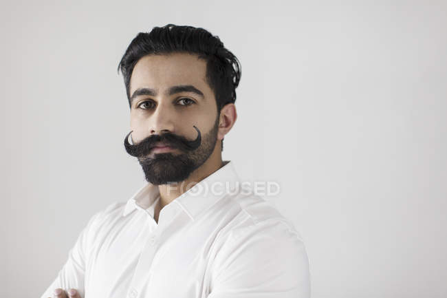 Portrait confident, serious young man with handlebar mustache — Stock Photo