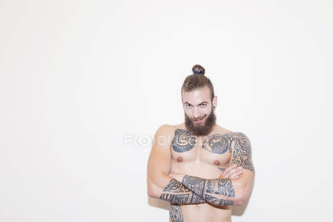 Portrait confident male hipster with bare chest and tattoos — Stock Photo