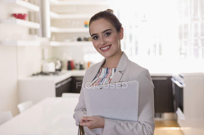 Portrait smiling, confident female real estate agent — Stock Photo
