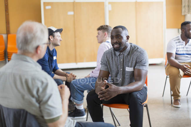 Men talking in community center — Stock Photo