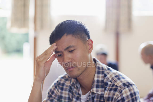 Frustrated man with head in hands — Stock Photo