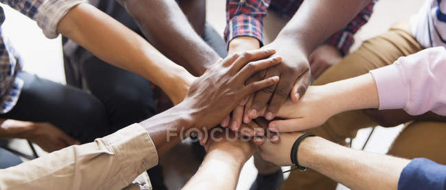 Men joining hands in group therapy — Stock Photo