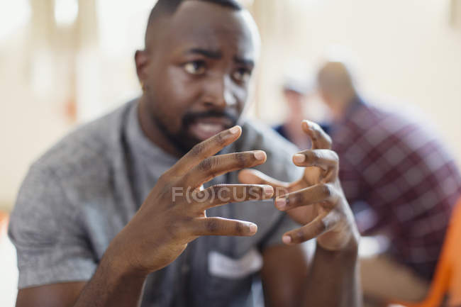 Man talking, gesturing with hands — Stock Photo