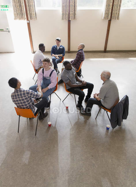 Men talking in group therapy — Stock Photo