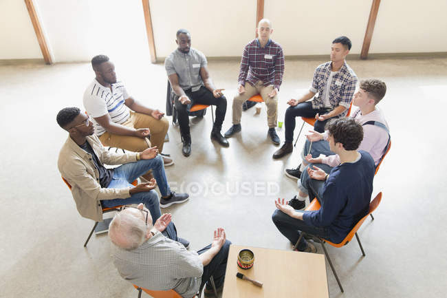 Men praying in circle in prayer group — Stock Photo