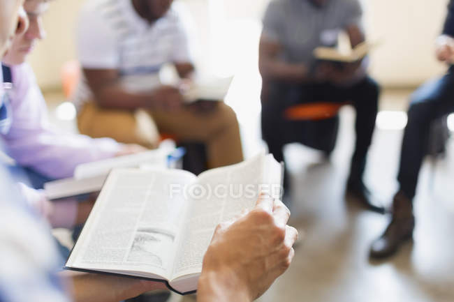 Men reading and discussing bible in prayer group — Stock Photo