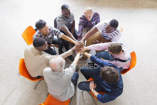 Men joining hands in circle in prayer group — Stock Photo