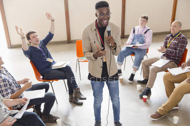 Man with microphone talking, leading group therapy — Stock Photo