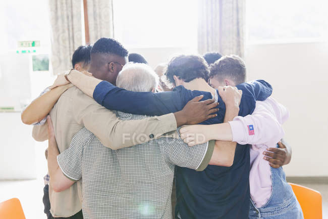 Men standing in huddle in prayer group — Stock Photo