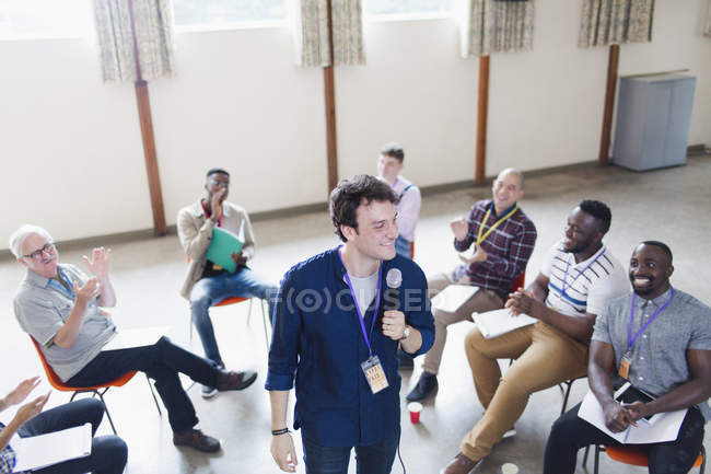 Group clapping for male speaker — Stock Photo