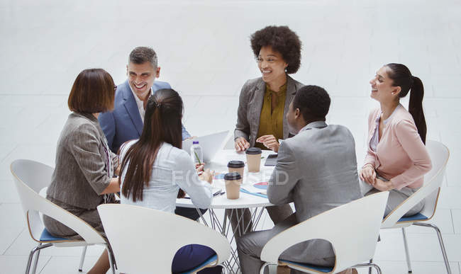 Smiling business people meeting at round table — Stock Photo