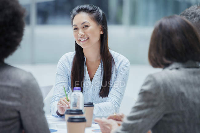 Smiling businesswoman in conference room meeting — Stock Photo