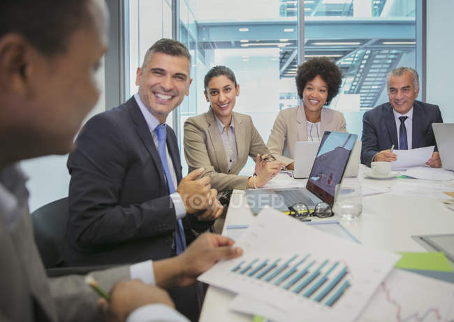 Smiling business people in conference room meeting — Stock Photo