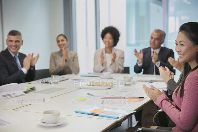Smiling business people clapping in conference room meeting — Stock Photo