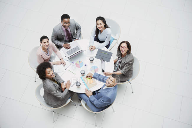 High angle portrait smiling, confident business people meeting at round table — Stock Photo