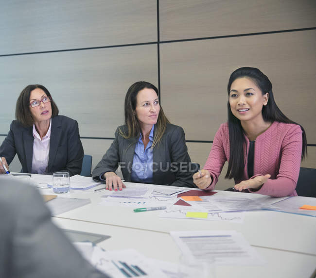 Businesswoman talking in conference room meeting — Stock Photo