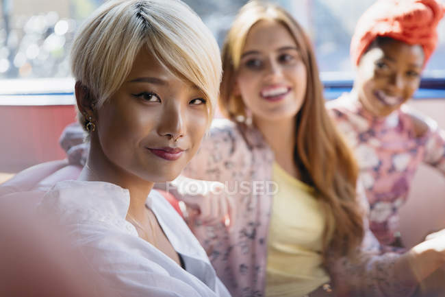 Portrait confident young women friends taking selfie — Stock Photo