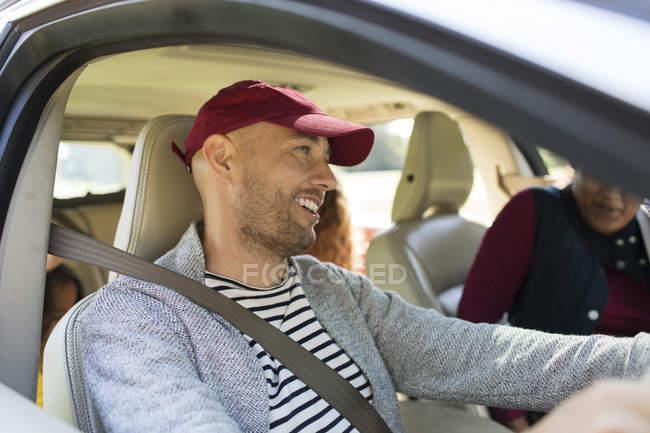 Smiling man driving car — Stock Photo