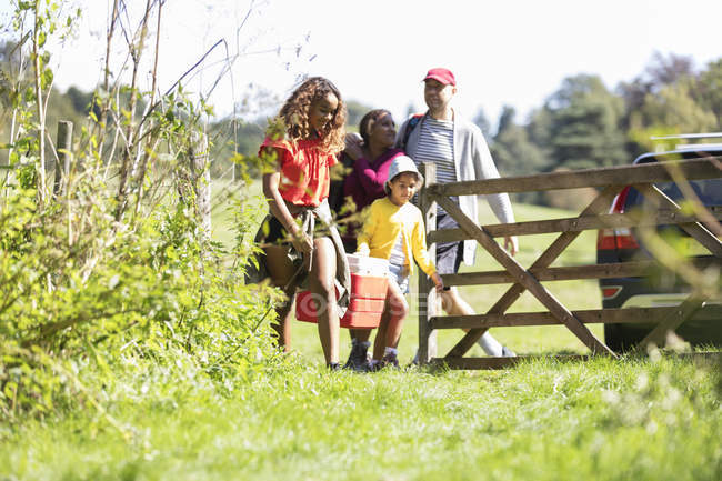 Family camping, walking in sunny field — Stock Photo
