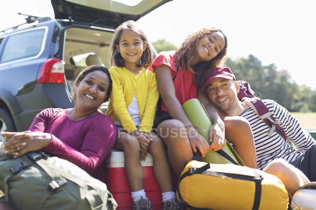 Portrait happy family camping, unloading car — Stock Photo