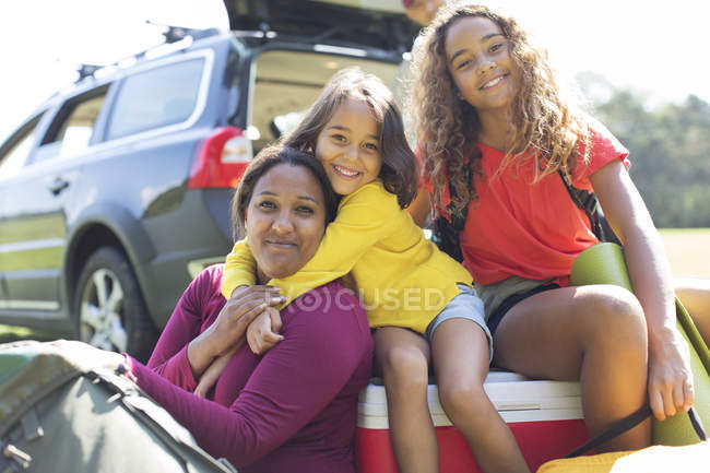 Portrait happy mother and daughters camping — Stock Photo