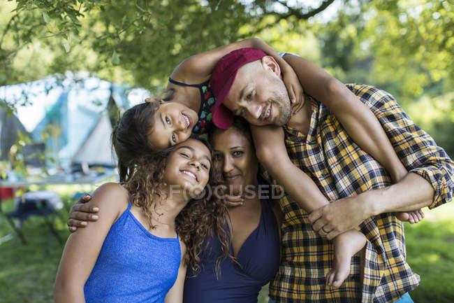 Portrait happy, carefree family at campsite — Stock Photo