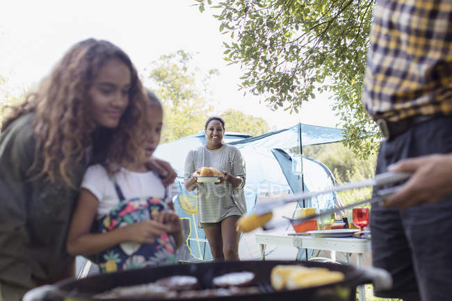 Family barbecuing at campsite — Stock Photo