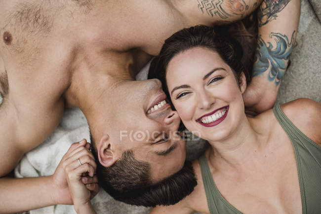 Portrait from above happy, affectionate young couple — Stock Photo