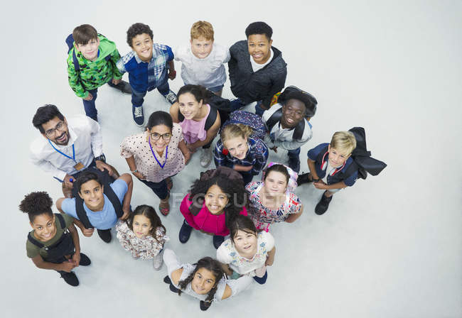 Portrait confident junior high students and teachers from above — Stock Photo