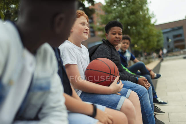 Tween boys with basketball in schoolyard — Stock Photo