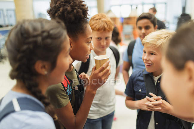 Junior high students hanging out, talking — Stock Photo