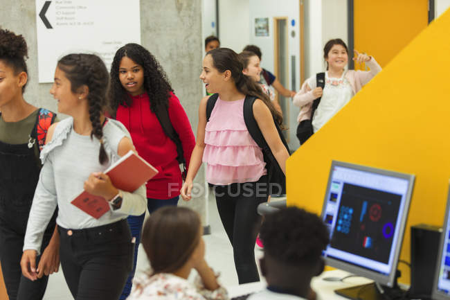 Junior high girl students entering library — Stock Photo