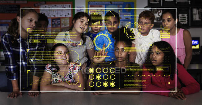 Junior high school students using futuristic touch screen in classroom — Stock Photo