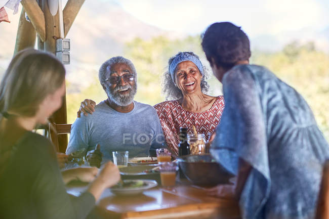 Happy senior couple enjoying breakfast on yoga retreat — Stock Photo